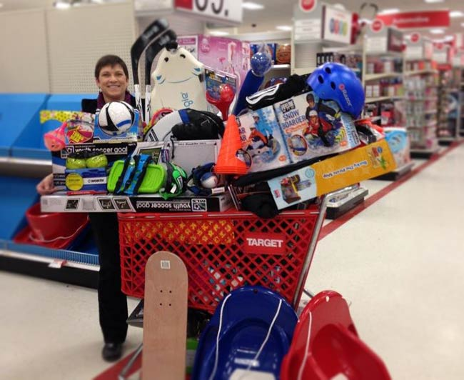 Holiday Wishes shopping cart overflowing with purchases