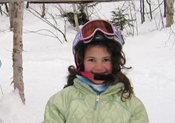 little girl skiing - donate